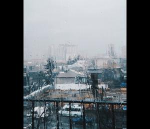 rain on window overseeing city storm