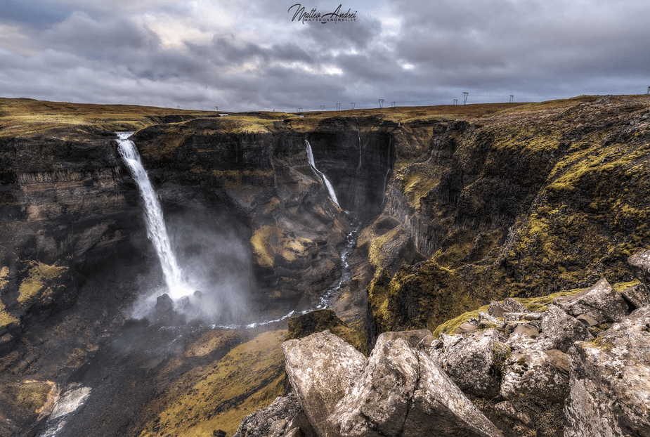 waterfalls over a cliff on a stormy day
