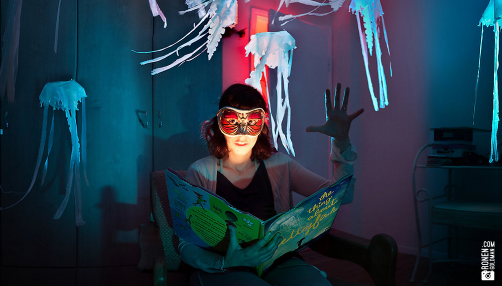 Woman in mask reading a bedtime story