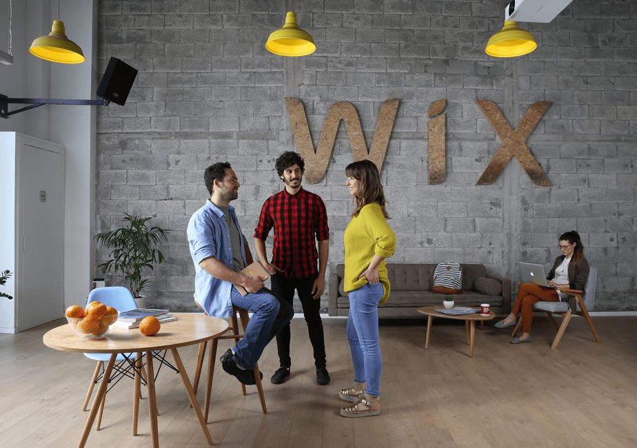 Photo of young people in Wix offices