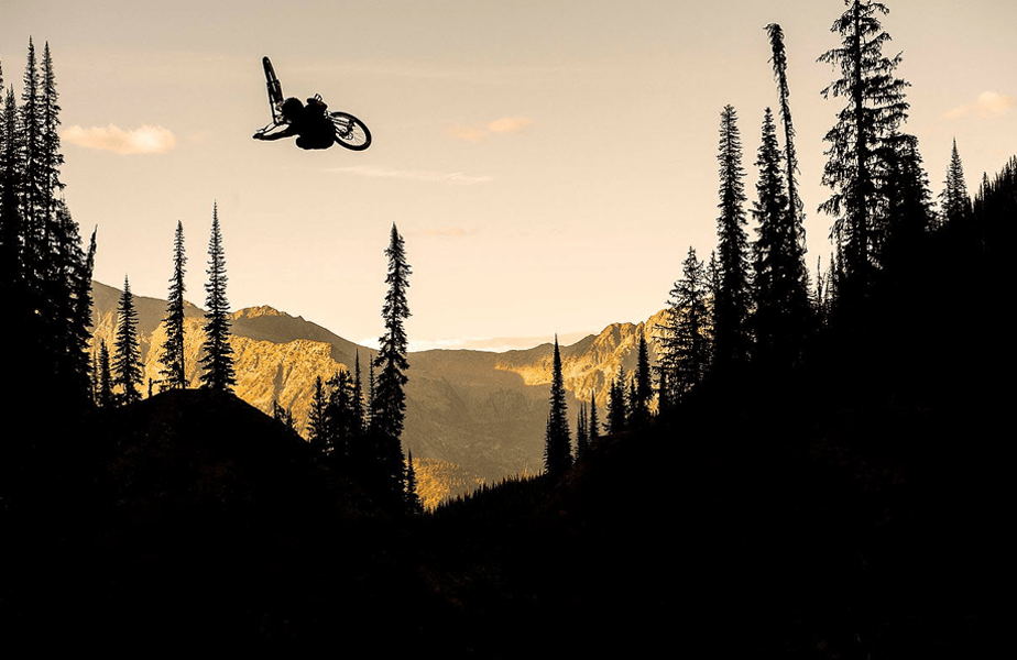 biker performing a trick mid-jump