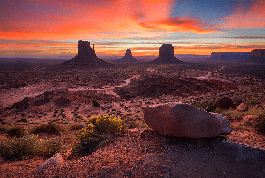 colorful red sunset at monument valley