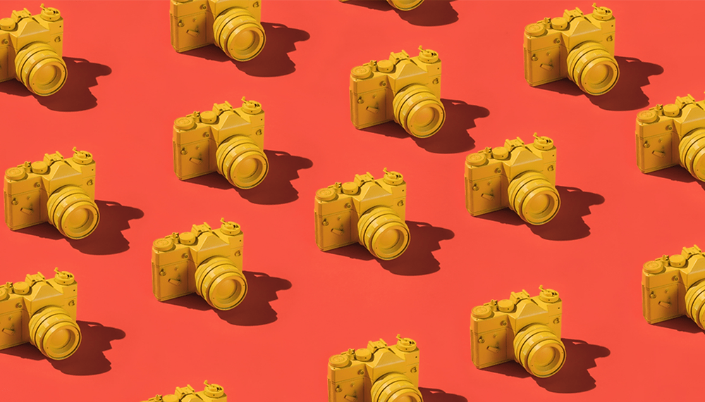 yellow camera illustrations on a red background