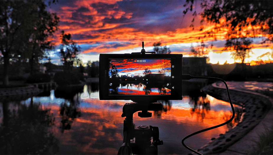smartphone recording sunset video
