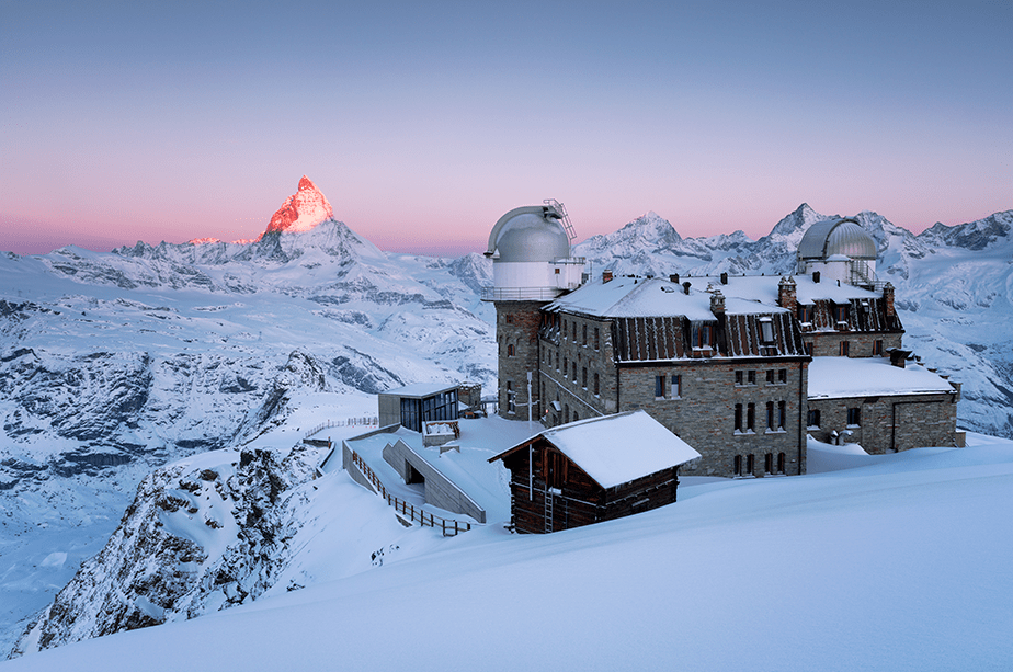 sunrise at matterhorn mountain covered with snow