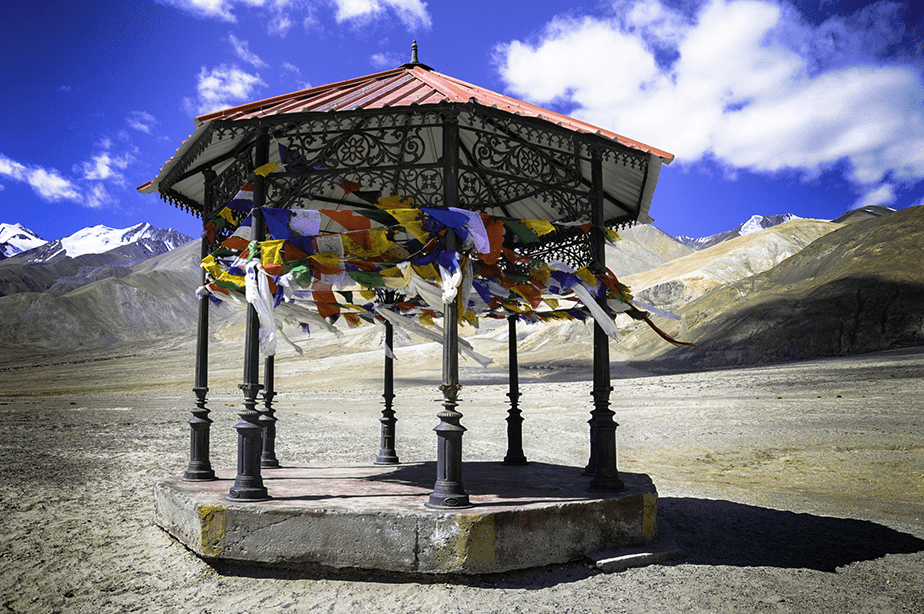 nepal structure with colorful flags on mountains