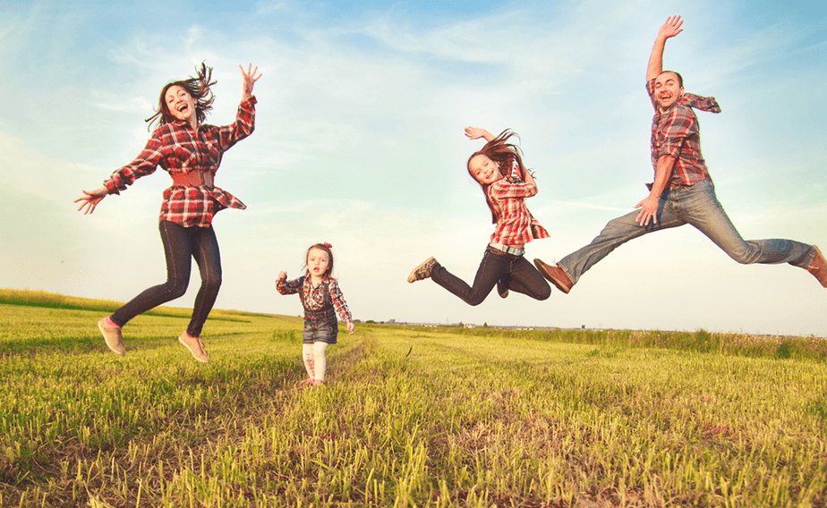 Jumping people in a field.