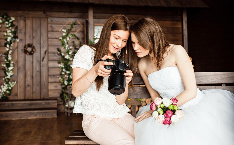 Wedding photographer showing photos to the bride