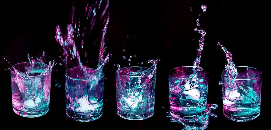 neon color shot glasses with liquid splash