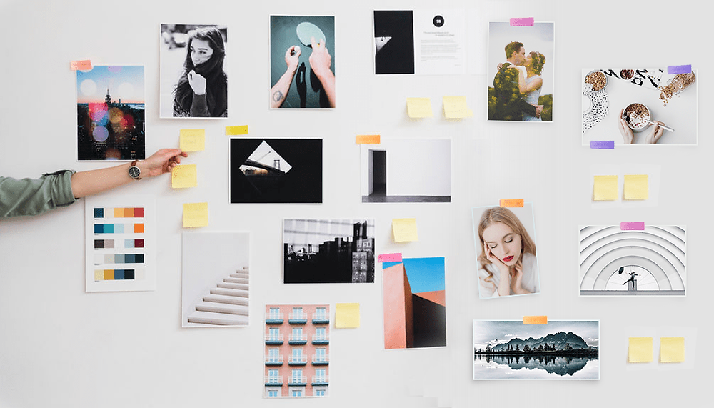photos and post-its on a white wall