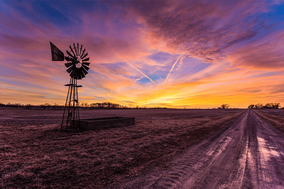 sunset at rural field in ohio with windmill