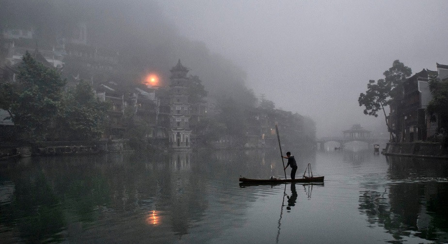 Traditional boat on a river at night in China by Wix photographer Viktor Molnar