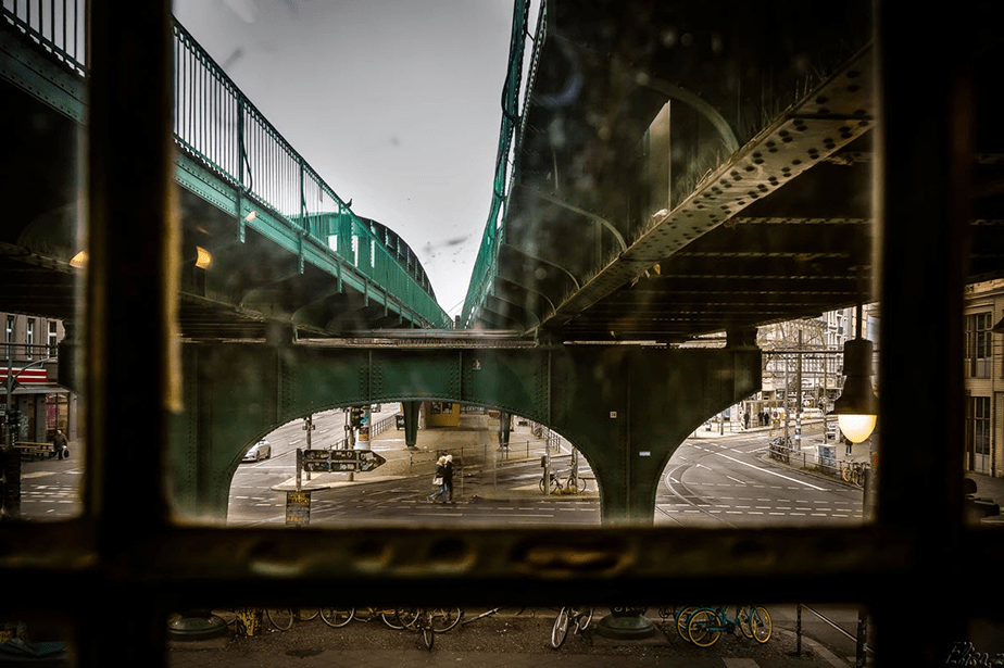 metal bridge seen from an old window on a rainy day