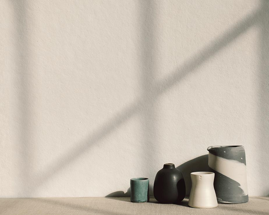 minimalist artistic jars on white wall