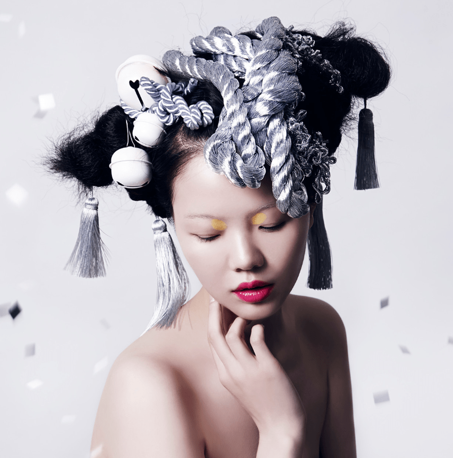 A fashion model with stuff on her head