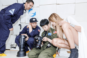 Photographer and model in zero gravity flight look at the photographer's camera