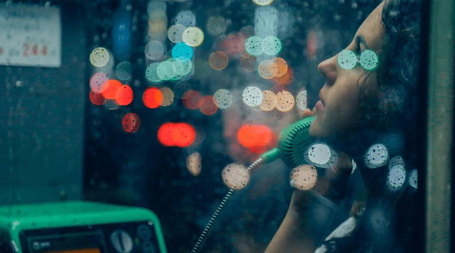 bokeh lights over girl talking on payphone