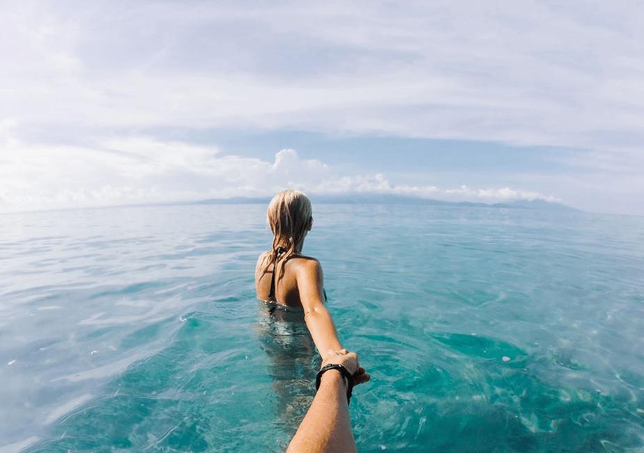 follow me couple on the sea