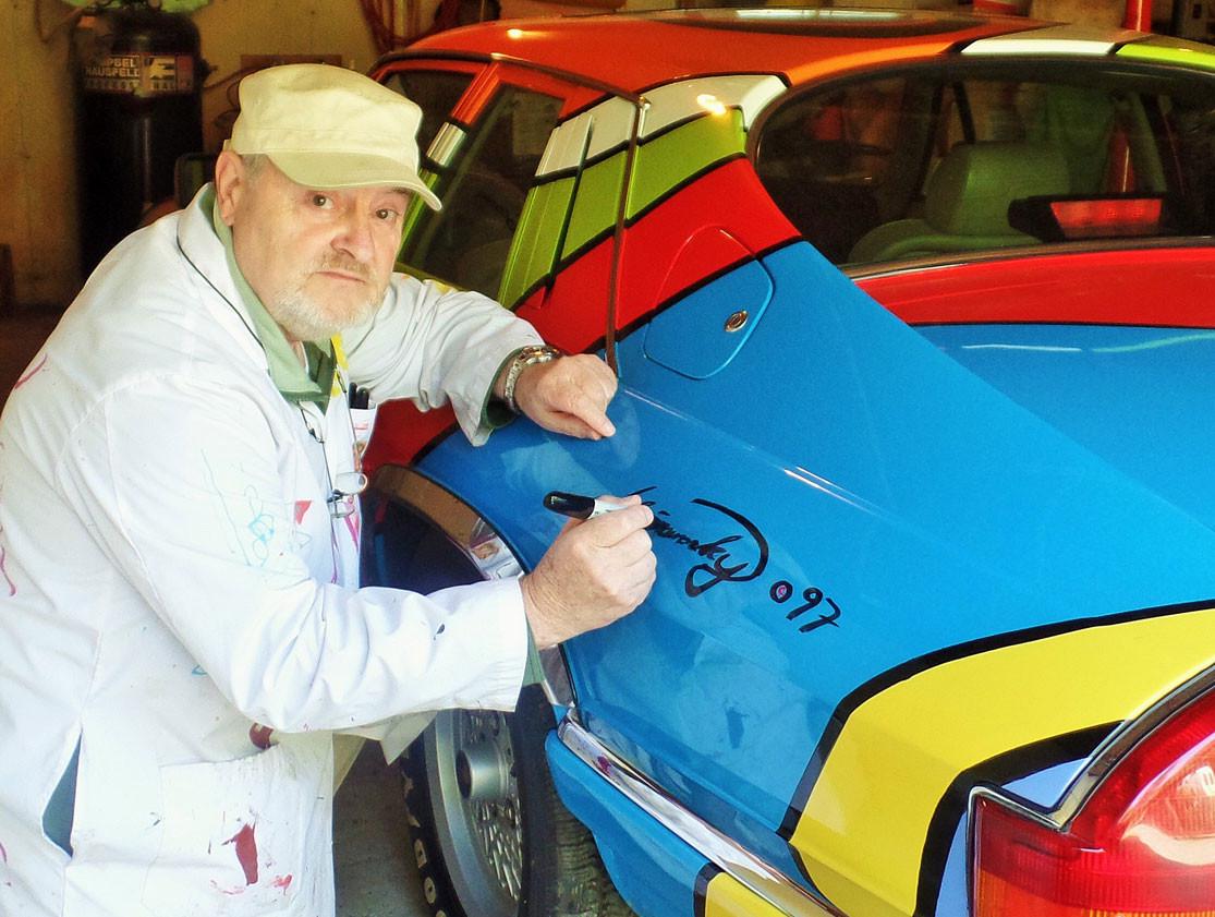 Leo Signing Art Car