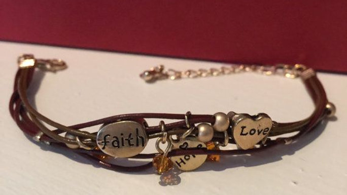 Brown leather bracelet with charms