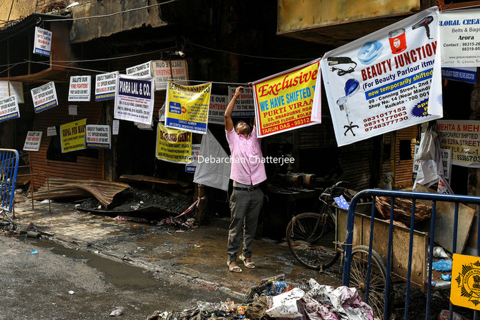 Owners hanging banners for arriving customers to get in touch with them as Bagree market is closed off until further notice.