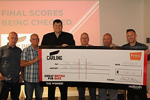 GBPQ Four Tops with cheque.jpg