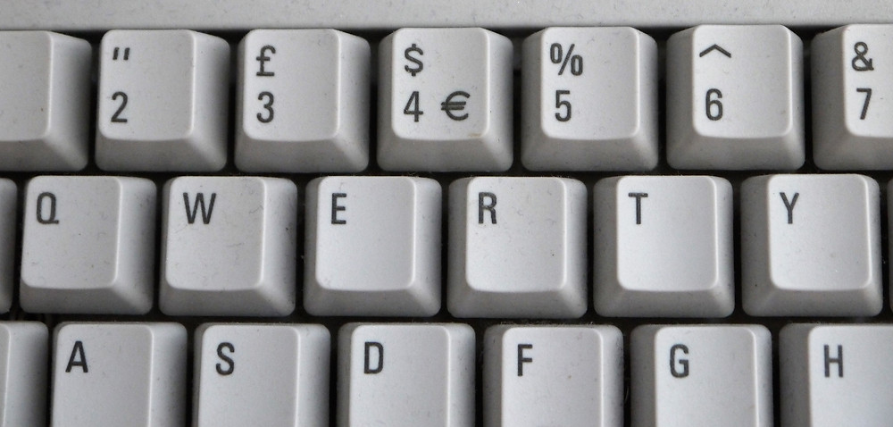 Photo of part of a keyboard showing QWERTY