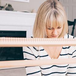 Rebecca Riel weaving at her loom - Riel Finishings