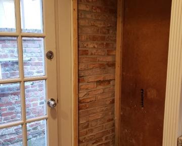 Rebuild of interior wall and masonr restoration and tuckpointing