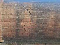 Stair-step brick masonry cracks