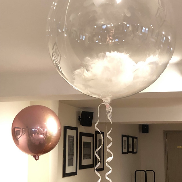 Crystal Clear Feather Balloon.jpg