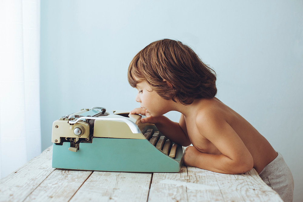Child playing with type writer