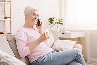 cheerful-senior-lady-having-phone-call-o