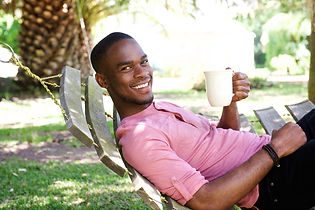young-african-man-with-a-coffee-relaxing