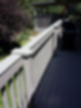 Deck railing covered with trex to repair damges to wood by hail dents. ACP Repairs your house right