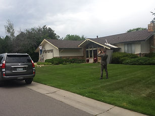 Alan Podvin snapping a picture of work for insurance ACP Storm Repair hail and roof contractor Greenwood Village Colorado