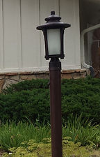 Post Light exterior light replaced as part of hail claim for Travelers Insurance Greenwood village Colorado