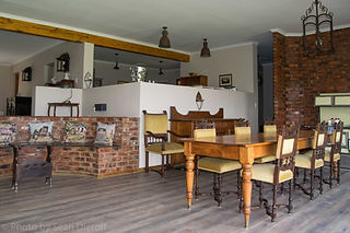 Maluti View dining room with kitchen abo