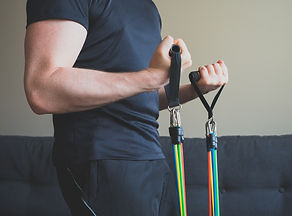 Man doing exercises with resistance band