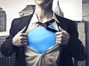 Closeup of a businessman showing the superhero suit under his shirt.jpg