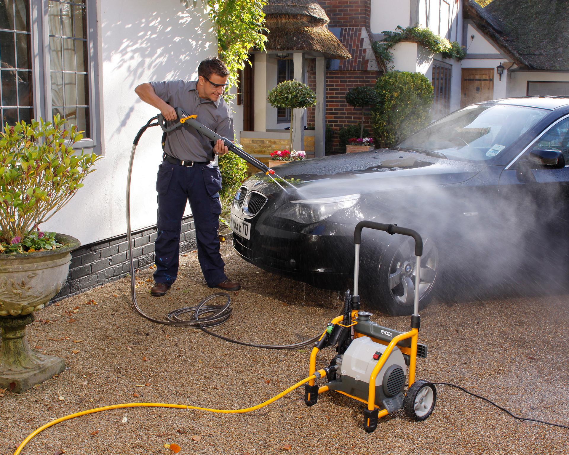 photo of man washing car