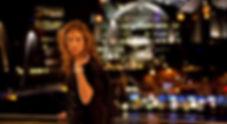 photo of girl on bridge