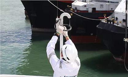 Engineer installing marine electronics