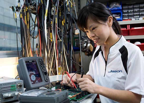 Engineer repairing electronics