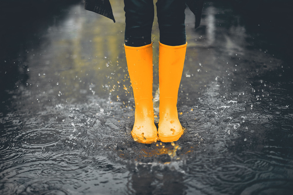 yellow boots in a puddle