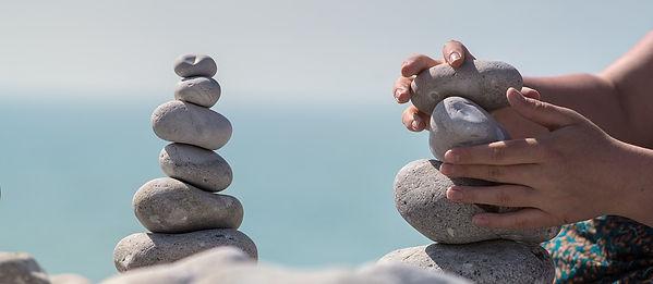 hands balancing stones.jpg
