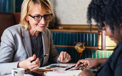 adults-businesswomen-coffee-1643323.jpg