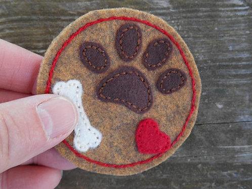 Dog paw refrigerator magnet