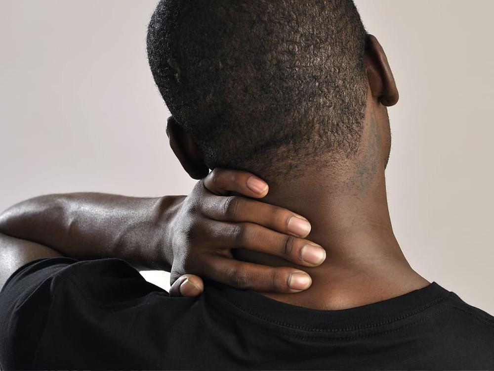 man massaging neck