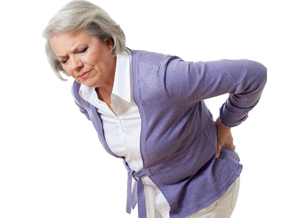 older woman hunched over holding back